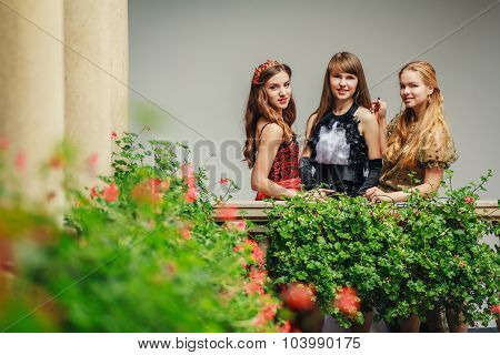 Three Beautiful Young Women In Evening Dresses