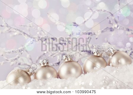 Pastel colored ornaments on snow