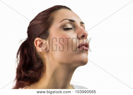 Close-up of woman with eyes closed against white background