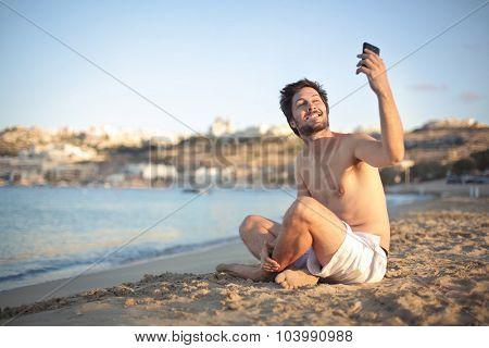 Man doing a selfie at the beach