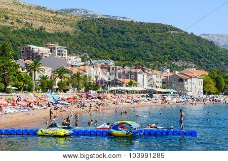 People Are Relaxing On Beach Of Resort Of Petrovac, Montenegro
