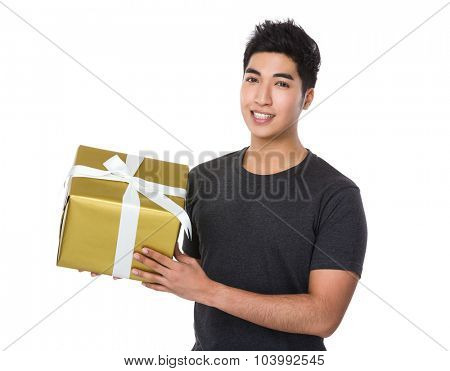 Asian young man hold with present box