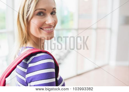 Close-up portrait of happy young female student in college