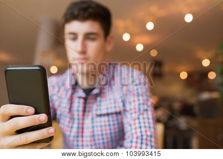 Low angle view of young man using mobile phone