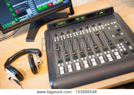High angle view of sound mixer on desk in radio station