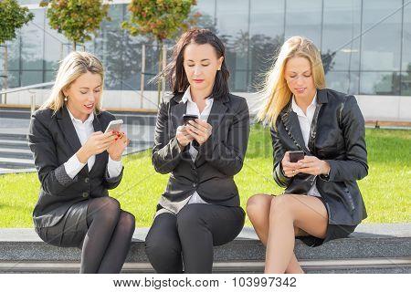 Business women on their cellphones