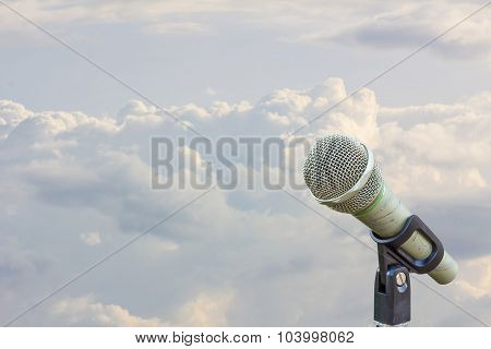 Microphone On A Stand With Blurred White Clouds Before Raining In The Evening, Copyspace On The Left
