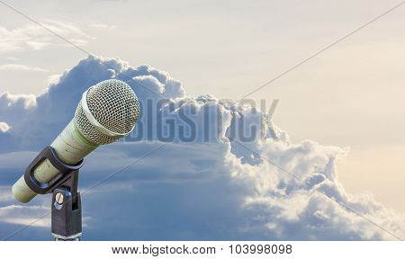 Microphone On A Stand With Blurred Gray Big Cloud Before Raining In Twilight, Copyspace On The Right