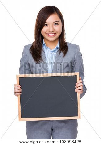 Young businesswoman show with the blank blackboard
