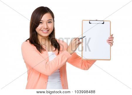 Asian young woman pen point to blank page of clipboard