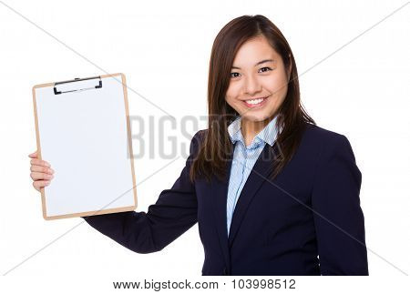 Businesswoman show clipboard with blank paper