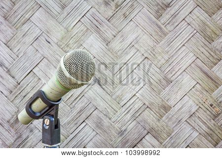 Microphone On A Stand With Blurred Pattern And Design Of Thai Style Bamboo Handcraft, Copyspace.