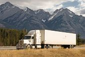 stock photo of 18 wheeler  - a truck stops in a rest area in the canadian rockies - JPG