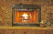 image of cozy hearth  - cozy fireplace with stone hearth and cast iron tools - JPG