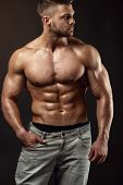 Strong Athletic Man Fitness Model Torso Showing Big Muscles poster