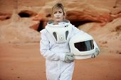 Постер, плакат: futuristic astronaut without a helmet on another planet image with the effect of toning