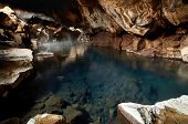 Famous hot spring cave in Iceland grjotagja has water above 50 degrees celcius and is dangerous for  poster