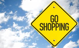 stock photo of going out business sale  - Go Shopping sign with sky background - JPG
