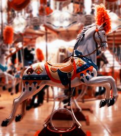 stock photo of carousel horse  - Retro carousel at night. Horse in electric light ** Note: Shallow depth of field - JPG