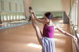 pic of ballet barre  - The classic ballet dancer posing at ballet barre on a rehearsal room background - JPG