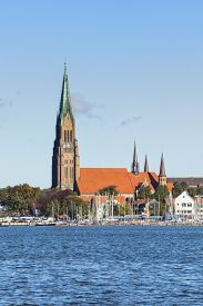 foto of inlet  - Cathedral at Schleswig with marina on Schlei inlet in foreground - JPG