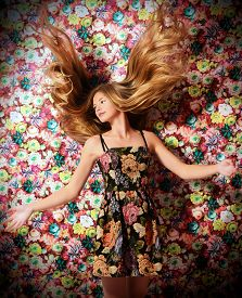 image of hair motion  - Beautiful girl with magnificent long hair in motion - JPG