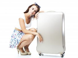 image of disappointed  - Unhappy and disappointed tourist woman with suitcase isolated white - JPG