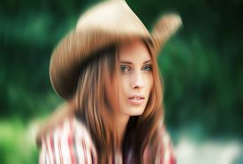 foto of cowgirl  - Soft focus blurred image of young woman portrait in a hat - JPG