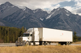 stock photo of moving van  - a truck stops in a rest area in the canadian rockies - JPG
