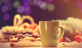 picture of eclairs  - Eclair and cup of coffee on wooden table - JPG