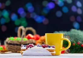 stock photo of eclairs  - Eclair and cup of coffee or tea on wooden table - JPG