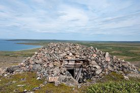 foto of murmansk  - Remains of a stone bunker from the Second World War on the seacoast of Rybachy peninsula near Murmansk Russia - JPG