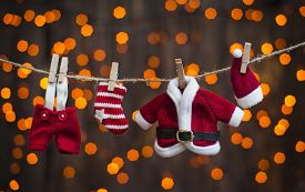 stock photo of clotheslines  - santa clothing on a clothesline on a background of lights - JPG