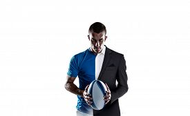 picture of half-dressed  - Rugby player holding ball against half a suit - JPG