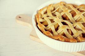 stock photo of shoulder-blade  - Homemade apple pie on wooden table - JPG
