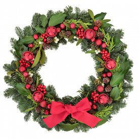 image of greenery  - Christmas wreath with red bauble decorations and bow - JPG