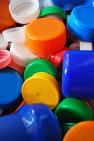 picture of plastic bottle  - Multicolored plastic bottle caps for recycling as background - JPG