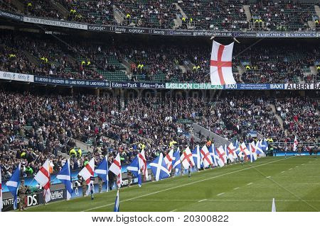 TWICKENHAM LONDON - MAR 13: Flags being paraded at England vs Scotland, England playing in white Win 22 -16, at RBS Six Nations Rugby Match on March 13, 2011 in Twickenham, England.