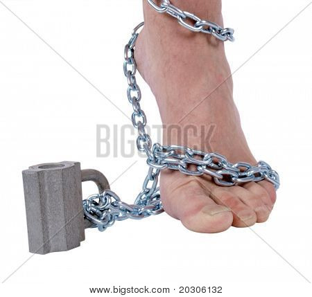 Color photo of male legs and a metal chain with a lock