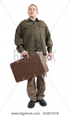 Color photo of a soldier with suitcase