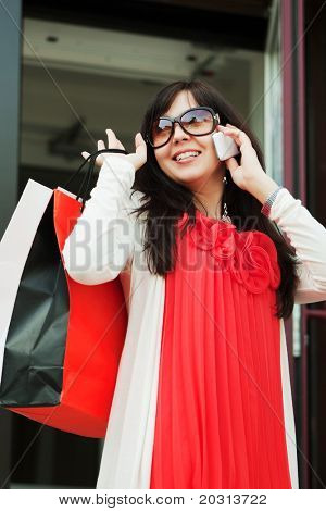 Young shopper calling on the phone.