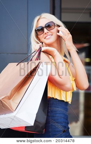 Happy shopper calling on the phone.