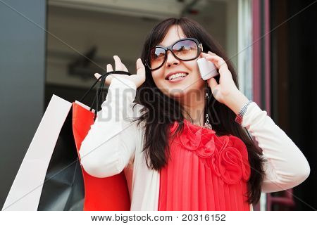 Happy shopper on the phone