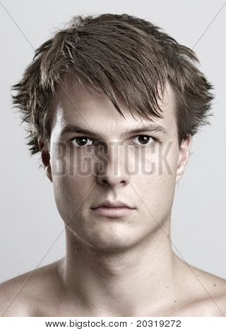 portrait of young man, desaturated
