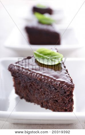 slices of chocolate cake, focus on texture in front