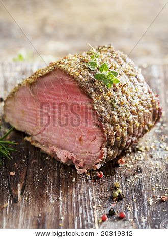 juicy roast beef covered in herbs
