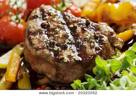close-up of juicy tenderloin beef covered in crushed mix of pepper