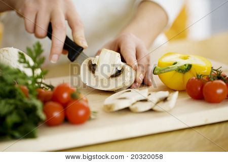 female chopping food ingredients