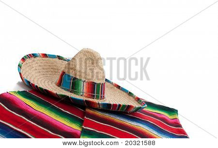 Mexican Serape and a sombrero on a white background with copy space