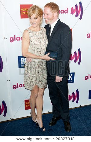 LOS ANGELES - APR 10: Jesse Tyler Ferguson (R) & Julie Bowen (L) arrive at the 22nd annual GLAAD Media Awards at Westin Bonaventure Hotel on April 10, 2011 in Los Angeles, CA.